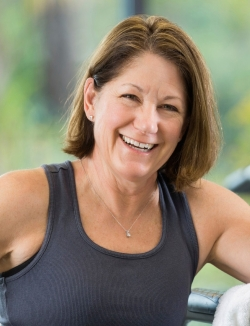 Woman Smiling At Cardio