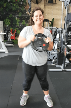 woman grooving out at the gym
